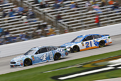 April 8, 2018 - Ft. Worth, Texas, United States of America - April 08, 2018 - Ft. Worth, Texas, USA: Kevin Harvick (4) and Paul Menard (21) battle for position during the O'Reilly Auto Parts 500 at Texas Motor Speedway in Ft. Worth, Texas. (Credit Image: © Chris Owens Asp Inc/ASP via ZUMA Wire)