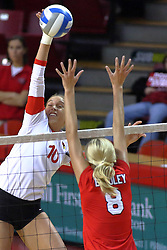 09 October 2009: Angela Rego strikes the ball towards Megan Schmidt and Skylar Lesan. The Redbirds of Illinois State defeated the Braves of Bradley in 3 sets during play in the Redbird Classic on Doug Collins Court inside Redbird Arena in Normal Illinois