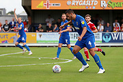 AFC Wimbledon defender Rod McDonald (4) lining up to shoot during the EFL Sky Bet League 1 match between AFC Wimbledon and Accrington Stanley at the Cherry Red Records Stadium, Kingston, England on 17 August 2019.