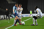 Wycombe Wanderers midfielder Jacob Gardiner-Smith (24) battles for possession  with Milton Keynes Dons midfielder Brennan Dickenson (11) during the EFL Trophy match between Milton Keynes Dons and Wycombe Wanderers at stadium:mk, Milton Keynes, England on 12 November 2019.