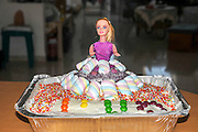 Barbie Doll birthday cake decorated with smarties and hundreds and thousands
