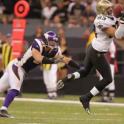 2008 October, 06: New Orleans Saints tight end Billy Miller (83) catches a pass in front of Minnesota Vikings linebacker Ben Leber (51) during a week five regular season game between the Minnesota Vikings and the New Orleans Saints for Monday Night Football at the Louisiana Superdome in New Orleans, LA.
