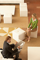 Businessman and woman in waiting room elevated view