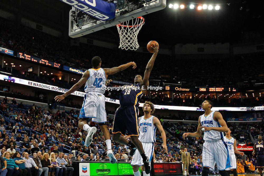 Dec 22, 2012; New Orleans, LA, USA; Indiana Pacers center Ian Mahinmi (28) shoots over New Orleans Hornets small forward Lance Thomas (42) during the first quarter of a game at the New Orleans Arena. Mandatory Credit: Derick E. Hingle-USA TODAY Sports