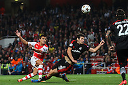 Alexis Sanchez of Arsenal shoots at goal under pressure from Pedro Franco of Besiktas J.K. during the UEFA Champions League match at the Emirates Stadium, London<br /> Picture by David Horn/Focus Images Ltd +44 7545 970036<br /> 27/08/2014