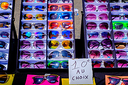 Sun glasses for sale on a market stall in Honfleur, Normandy, France