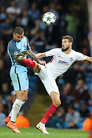 Football - 2016 / 2017 Champions League - Qualifying Play-Off, Second Leg: Manchester City [5] vs. Steaua Bucharest [0]<br /> <br /> Aleksandar Kolarov of Manchester City and Alexandru Tudorie of Steaua Bucharest during the match, at the Ethihad Stadium.<br /> <br /> COLORSPORT/LYNNE CAMERON