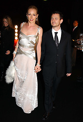 CAT DEELEY and her boyfriend at the Moet & Chandon Fashion Tribute 2005 to Matthew Williamson, held at Old Billingsgate, City of London on 16th February 2005.<br />