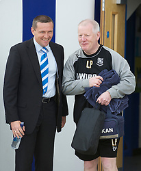 COLCHESTER, ENGLAND - Saturday, April 24, 2010: Tranmere Rovers' Manager Les Parry and Colchester United's Manager Aidy Boothroyd exchange words before the Football League One match at the Western Community Stadium. (Photo by Gareth Davies/Propaganda)