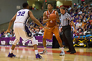 FORT WORTH, TX - JANUARY 19: Demarcus Holland #2 of the Texas Longhorns brings the ball up court against the TCU Horned Frogs on January 19, 2015 at Wilkerson-Greines AC in Fort Worth, Texas.  (Photo by Cooper Neill/Getty Images) *** Local Caption *** Demarcus Holland
