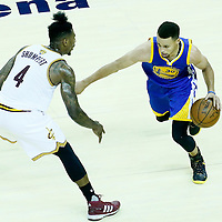 08 June 2016: Golden State Warriors guard Stephen Curry (30) drives past Cleveland Cavaliers guard Iman Shumpert (4) during the Cleveland Cavaliers 120-90 victory over the Golden State Warriors, during Game Three of the 2016 NBA Finals at the Quicken Loans Arena, Cleveland, Ohio, USA.