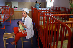 Khadija Hamraoui, 21, takes a break from her job at a local bakery to breast feed her three-month-old daughter Meriem in Casablanca, Morocco on May 6, 2009. Khadija Hamraoui came to Solidarité Féminine after getting pregnant. While she was able to find work and housing with the help of Solidarité Féminine, she still has yet to inform her parents about her new baby. Solidarité Féminine is a locally founded non-profit organization that helps single mothers in Casablanca live dignified lives. The association helps young single mothers who have traditionally been discriminated against in Morocco, with job training, housing, childcare, and literacy.