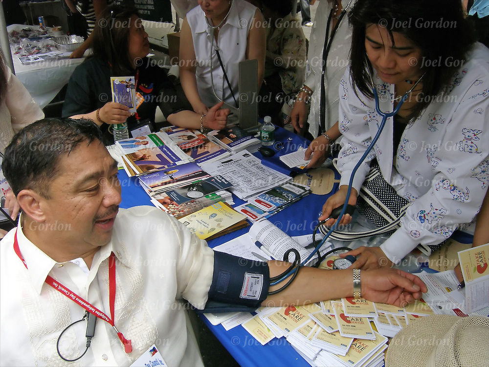 Free blood pressure testing to test risk of stroke and heart attact, at Philippine Street fair multi-cultural in Madison Square Park