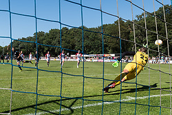 Reuven Niemeijer of Heracles Almelo scores a penalty against goelkeeper Kjell Scherpen of FC Emmen during the Friendly match between Heracles Almelo and FC Emmen at Sportcomplex 't Brook on July 14, 2018 in Bornerbroek, The Netherlands