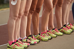 Falmouth Road Race: The Cochary High School Mile, Girls, competitors pose for group picture, track spikes detail