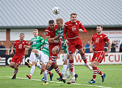 RHOSYMEDRE, WALES - Sunday, May 5, 2019: Connah's Quay Nomads's Michael Wilde and Connah's Quay Nomads's John Disney challenge Blaine Hudson for a header but the ball goes past everyone for a third goal during the FAW JD Welsh Cup Final between Connah's Quay Nomads FC and The New Saints FC at The Rock. (Pic by David Rawcliffe/Propaganda)