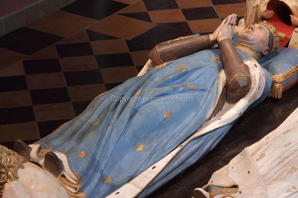 Effigy of John the Fearless, from the tomb of Jean sans Peur, or John the Fearless, 1371-1419, (Jean de Valois or John of Valois, Jean I, duc de Bourgogne, or John I, Duke of Burgundy) and his wife Marguerite de Baviere, or Margaret of Bavaria, 1363- 1423, 1443-70, by Jean de la Huerta, 1413-62, and Antoine le Moiturier, 1425-97, in the Grande Salle du Palais des ducs de Bourgogne, or Salle des Gardes, a 15th century Flamboyant Gothic hall, in the Musee des Beaux-Arts de Dijon, opened 1787 in the Palace of the Dukes of Burgundy in Dijon, Burgundy, France. The tomb consists of painted alabaster effigies with lions and angels, and below, figures of pleurants or weepers among Gothic tracery. The tomb was begun in 1443 (24 years after his death), by Jean de La Huerta, and Antoine le Moiturier after 1456, and finally installed in 1470. The tombs were originally from the Chartreuse de Champmol, or Chartreuse de la Sainte-Trinite de Champmol, a Carthusian monastery which was sacked in the French Revolution and the tombs moved to Dijon cathedral then here in 1827. The effigies are 19th century reconstructions, the originals being destroyed in the French Revolution. Picture by Manuel Cohen