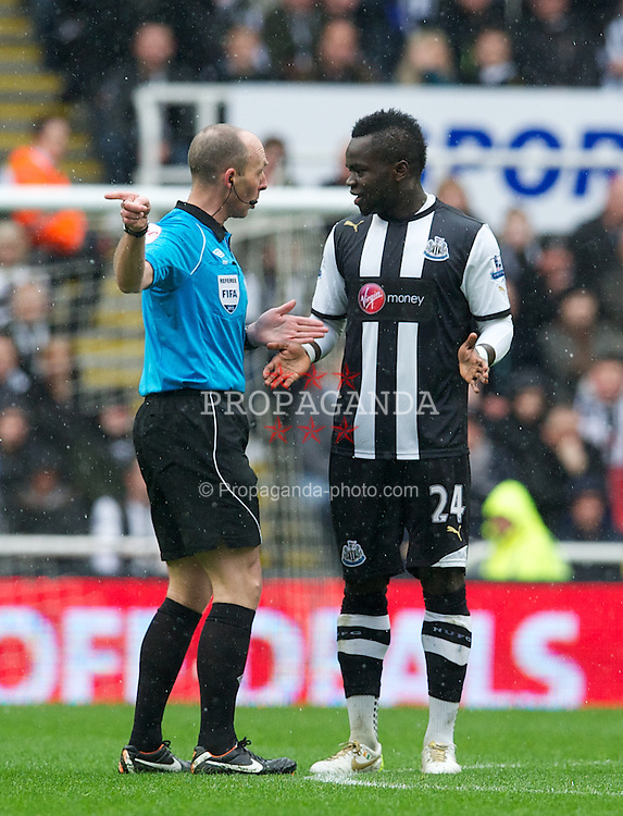 NEWCASTLE, ENGLAND - Sunday, March 4, 2012: Referee Mike Dean speaks to Newcastle United's Cheick Tiote but doesn't book him during the opening exchanges of the Premiership match against Sunderland at St. James' Park. (Pic by David Rawcliffe/Propaganda)