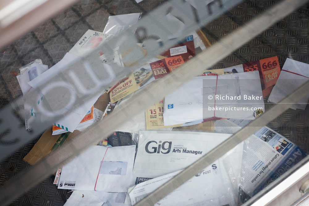 Piles of letters delivered to a cafe business on London's South Bank, a victim of the UK recession.