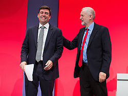 © Licensed to London News Pictures . 28/09/2016 . Liverpool , UK . Greater Manchester Mayoralty candidate ANDY BURNHAM shakes hands with JEREMY CORBYN after delivering his final speech as shadow Home Affairs spokesman , during the final day of the Labour Party Conference at the ACC in Liverpool . Photo credit : Joel Goodman/LNP