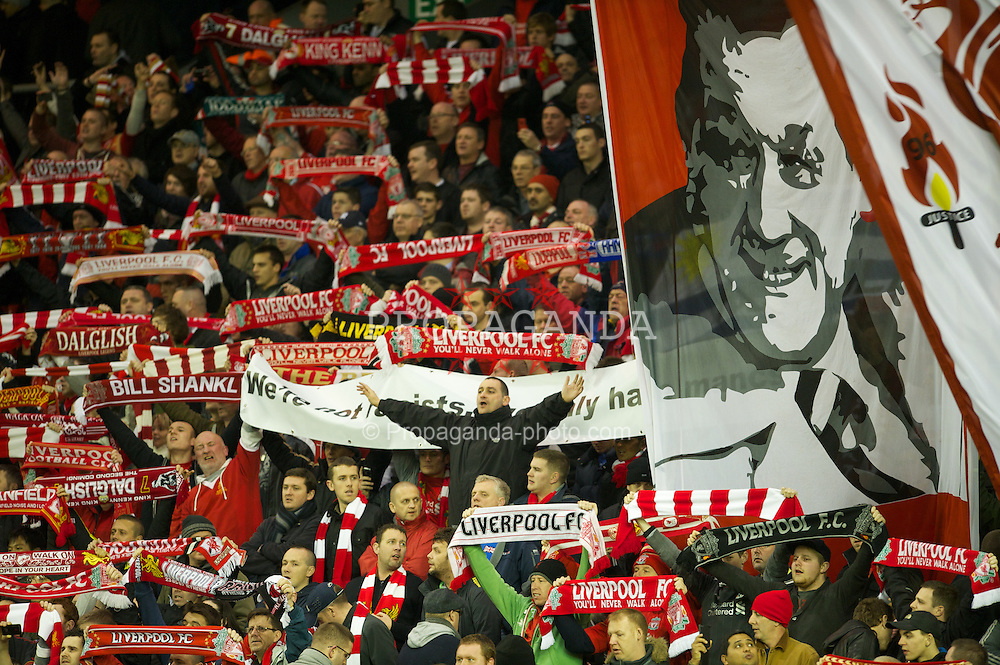 LIVERPOOL, ENGLAND - Wednesday, January 25, 2012: Liverpool supporters on the Spion Kop during the Football League Cup Semi-Final 2nd Leg match against Manchester City at Anfield. (Pic by David Rawcliffe/Propaganda)