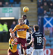 24th February 2018, Dens Park, Dundee, Scotland; Scottish Premier League football, Dundee versus Motherwell; Roarie Deacon of Dundee outjumps Richard Tait of Motherwell