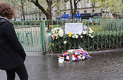 People pay tribute to victims of a terror attack in front of La Bonne Biere cafe in Paris, France, on November 13, 2016, marking the one year anniversary of a series of deadly attacks. Some 130 were killed, 90 of them at Bataclan, when Islamic militants went of the rampage in the heart of the French capital. Photo by Somer/ABACAPRESS.COM