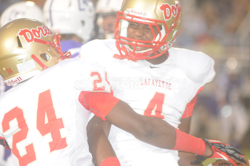 Lafayette High's Eric Lewis (4) and Lafayette High's Juwan Harden (24) vs. Desoto Central on Friday, September 6, 2013. Lafayette High won 21-6.