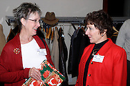 Elaine Middlestetter of Concept Company (left) and Jayne McDougall of McDougall Marketing during the holiday meeting of the American Advertising Federation at the NCR Country Club in Kettering, Thursday, December 15, 2011.