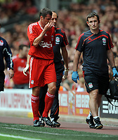 Jamie Carragher Goes off with Injury<br /> Liverpool 2009/10<br /> Liverpool V Atletico Madrid 08/08/09<br /> Pre Season Friendly 2009<br /> Photo Robin Parker Fotosports International