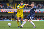 AFC Wimbledon defender Tennai Watson (2) battles for possession with Southend United attacker Harry Bunn (30) during the EFL Sky Bet League 1 match between Southend United and AFC Wimbledon at Roots Hall, Southend, England on 16 March 2019.