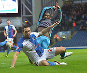 Sheffield Wednesday Defender, J?r?my Helan is topped in his tracks by Blackburn Rovers Defender, Shane Duffy during the Sky Bet Championship match between Blackburn Rovers and Sheffield Wednesday at Ewood Park, Blackburn, England on 28 November 2015. Photo by Mark Pollitt.