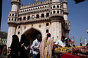 Tourists and local walk around the open market at Charminar, a famous landmark monument in Hyderabad, Andhra Pradesh, India on 28 November 2011. Photo by Suzanne Lee for Capa Pictures