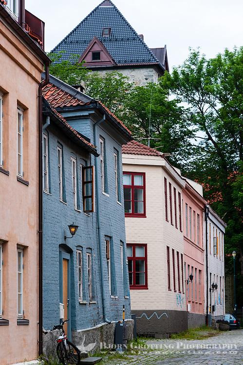 Norway, Sør-Trøndelag, Trondheim. Wooden houses in St. Jørgensveita. Vår Frue's Church in the back.