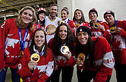 VANCOUVER, BC - MARCH 2:  Trevor Linden, captain of the 1994 Vancouver Canucks poses with members of the 2014 Canadian Olympic Women's gold medal hockey team prior to the 2014 Tim Hortons Heritage Classic between the Ottawa Senators and the Vancouver Canucks at BC Place on March 2, 2014 in Vancouver, B.C., Canada.  (Photo by Kevin Light/NHLI via Getty Images)