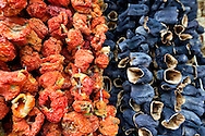 Dried tomatoes and dried aubergines hang outside a shop near the Egyptian or Spice Bazaar, Eminonu, Istanbul, Turkey