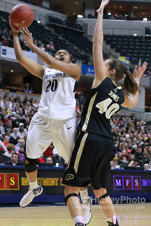 March 03, 2012; Indianapolis, IN, USA; Penn State Lady Lions guard Alex Bentley (20) shoots the ball against Purdue Boilermakers center Chelsea Jones (40) during the semifinals of the 2012 Big Ten Tournament at Bankers Life Fieldhouse. Purdue defeated Penn State 68-66. Mandatory credit: Michael Hickey-US PRESSWIRE