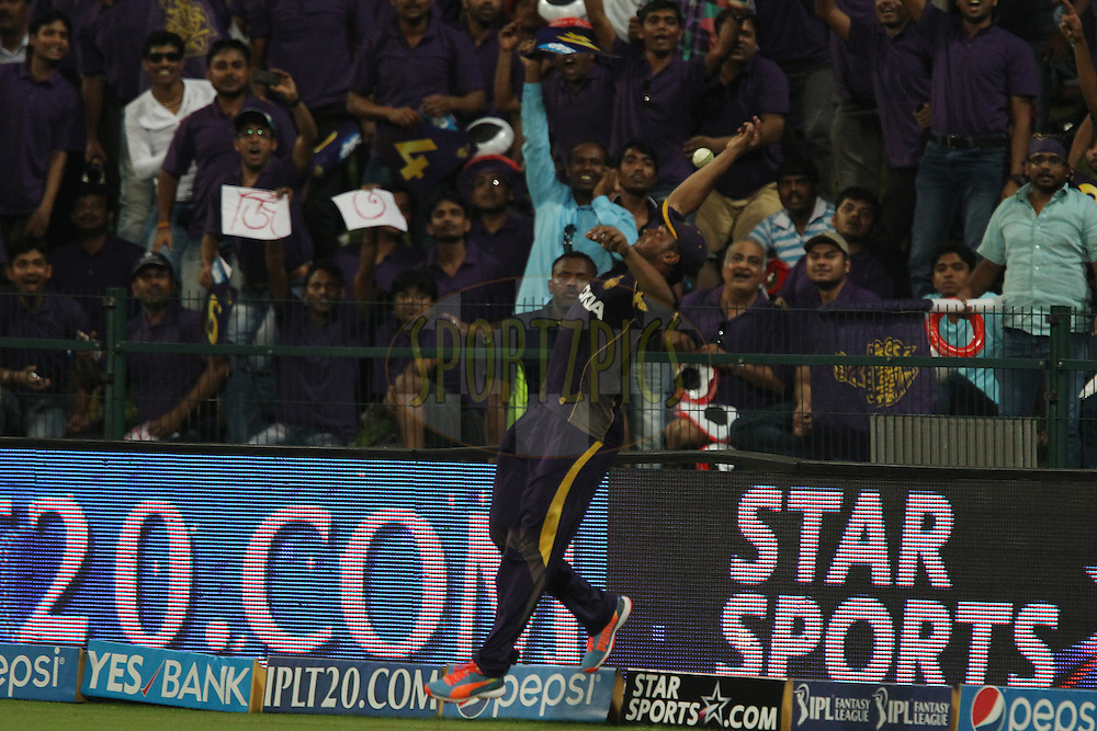 Shakib Al Hasan of the Kolkata Knight Riders jumps for the attempt at a catch during match 19 of the Pepsi Indian Premier League 2014 Season between The Kolkata Knight Riders and the Rajasthan Royals held at the Sheikh Zayed Stadium, Abu Dhabi, United Arab Emirates on the 29th April 2014<br /> <br /> Photo by Ron Gaunt / IPL / SPORTZPICS