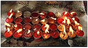 Candles at the feet of Buddha - Bodh Gaya