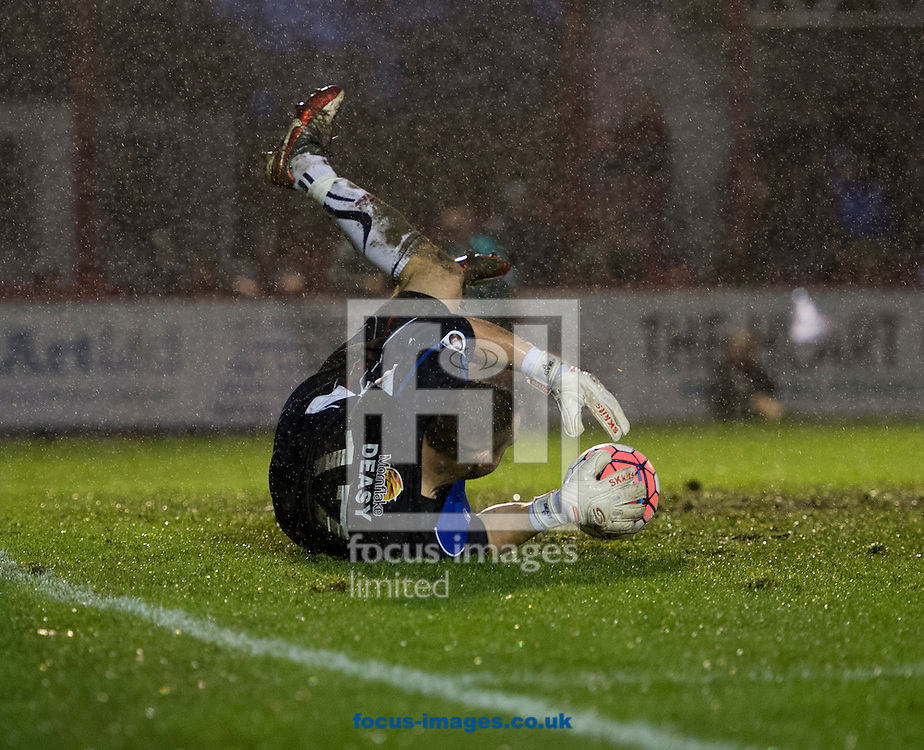 Altrincham goalkeeper Tim Deasy makes a save during the FA Cup match at Moss Lane, Altrincham<br /> Picture by Russell Hart/Focus Images Ltd 07791 688 420<br /> 07/11/2015