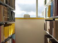 Library interior pile of books on windowsill