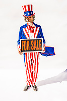 "Uncle Sam character with a ""For Sale"" sign around his neck.  Concept of government influence / corruption."