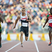 Men's 100 meter dash, (left-right) Jason Livermore-Jamaica, Andre Degrasse-Canada, and Antoine Adams-St. Kitts and Nevis, during athletics competition at the 2015 PanAm Games in Toronto.