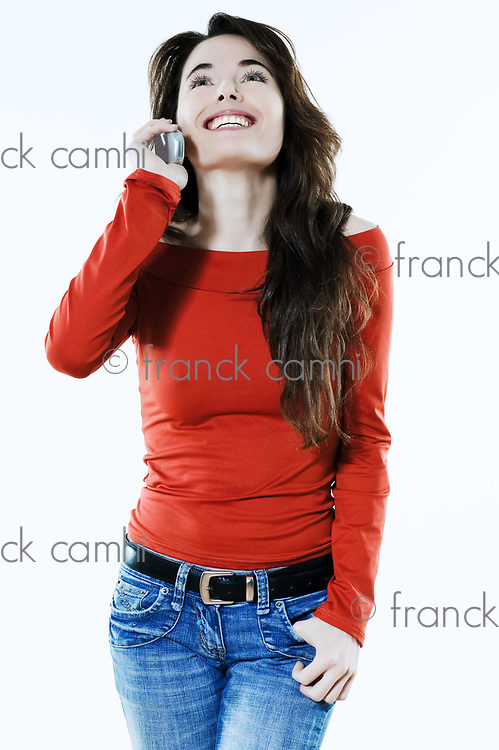 studio portrait of a expressive caucasian beautiful charming woman calling on the phone