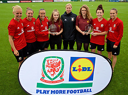 NEWPORT, WALES - Tuesday, June 5, 2018: Wales' captain Sophie Ingle, Loren Dykes, Natasha Harding, manager Jayne Ludlow, Angharad James and Kayleigh Green present trophies to Seren Mead and Elen Matthews during a training session at Dragon Park ahead of the FIFA Women's World Cup 2019 Qualifying Round Group 1 match against Bosnia and Herzegovina. (Pic by David Rawcliffe/Propaganda)