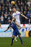 Leeds United midfielder Adam Forshaw (4) and Wigan Athletic midfielder Sam Morsy (5) during the EFL Sky Bet Championship match between Wigan Athletic and Leeds United at the DW Stadium, Wigan, England on 4 November 2018.