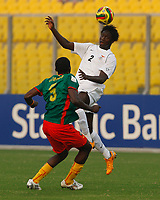 Photo: Steve Bond/Richard Lane Photography.<br /> Cameroun v Zambia. Africa Cup of Nations. 26/01/2008. jacob Mulenga (R) gets a header in above Thimothee Atouba (L)