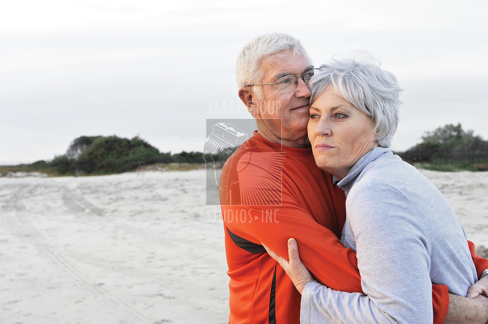 Medium shot of a senior couple at the beach