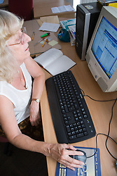 Woman sitting at a desk using a computer,