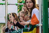 Performers on the back of a lorry applaud the spectators during the St Patrick's Day Parade in Westminster, London.<br /> Picture by Paul Davey/Focus Images Ltd +447966 016296<br /> 13/03/2016